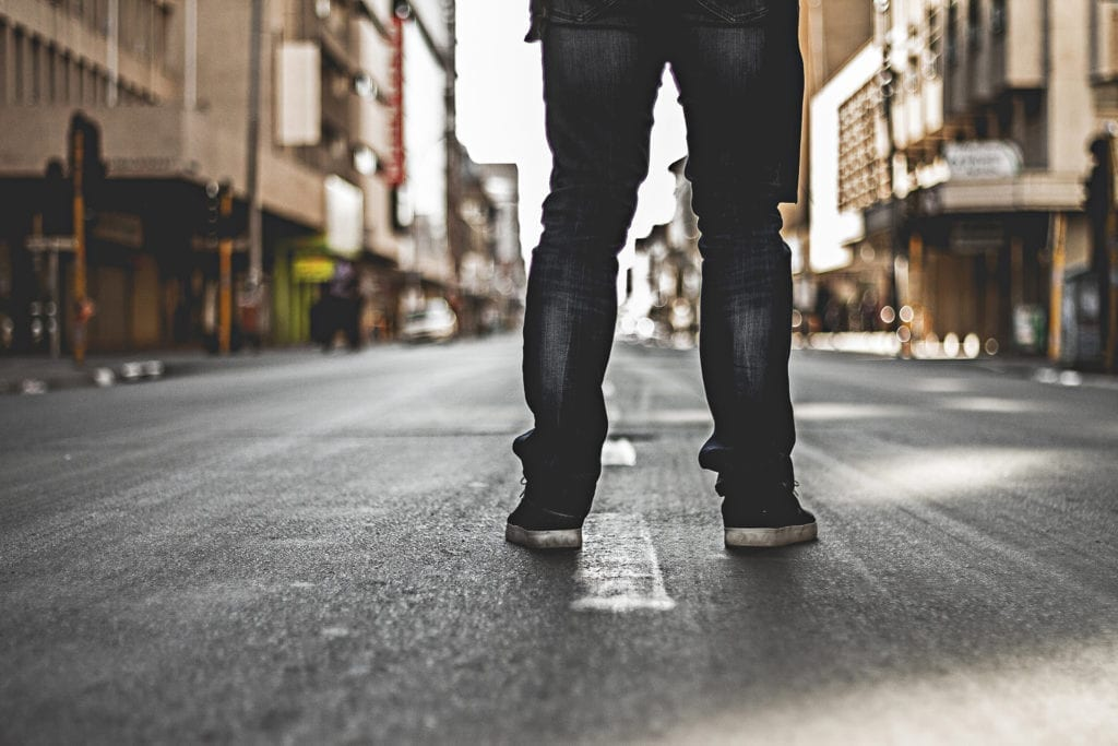 man stands in street