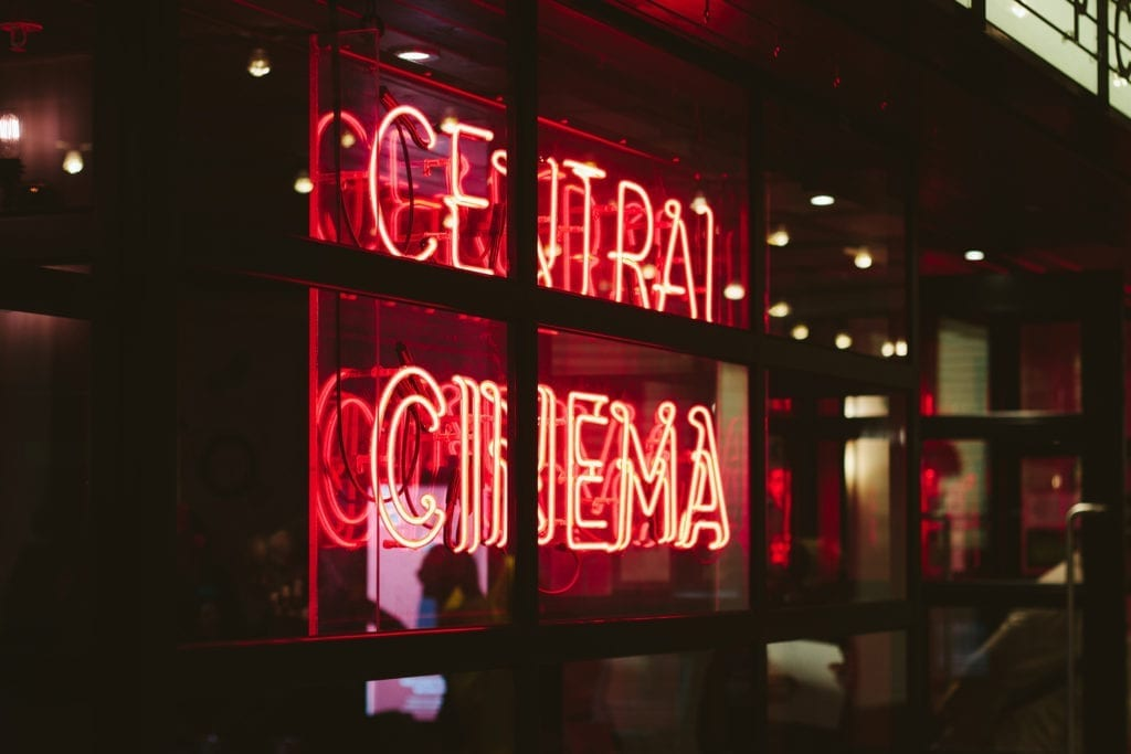 neon sign that says central cinema