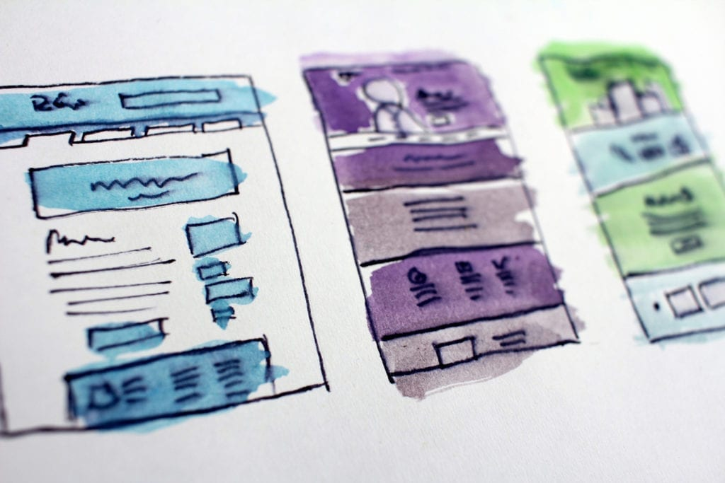 sketches of digital marketing strategy plans colorful grids and charts and posts and ux design