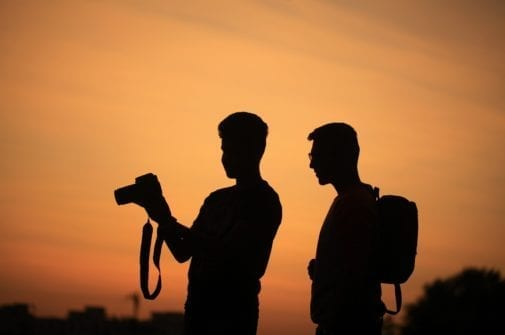 silhouette of two filmmakers with a camera