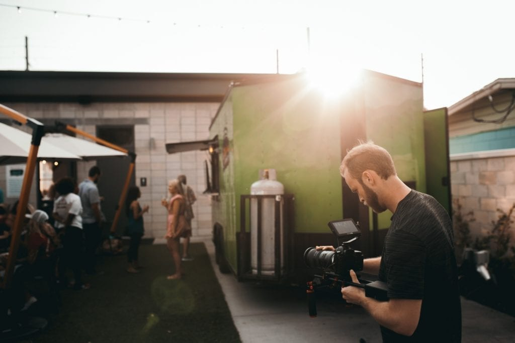 independent filmmaker with video camera