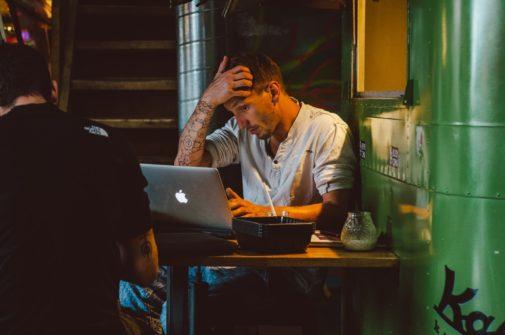 filmmaker sitting at laptop submitting short films to festivals