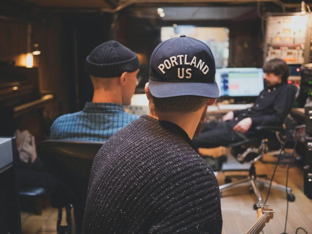 film producer on set short film wearing backwards hat