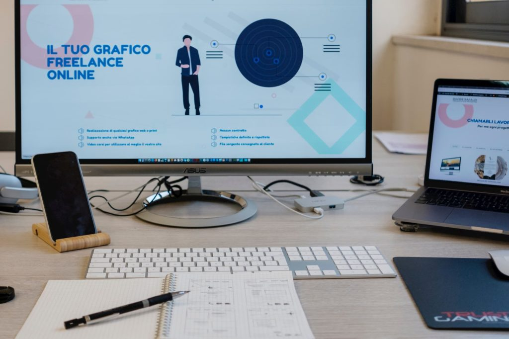 interactive producer designer at desktop monitor