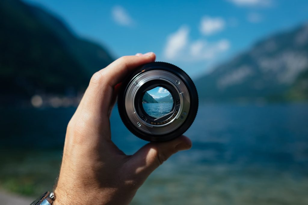 looking through lens at lake and mountains