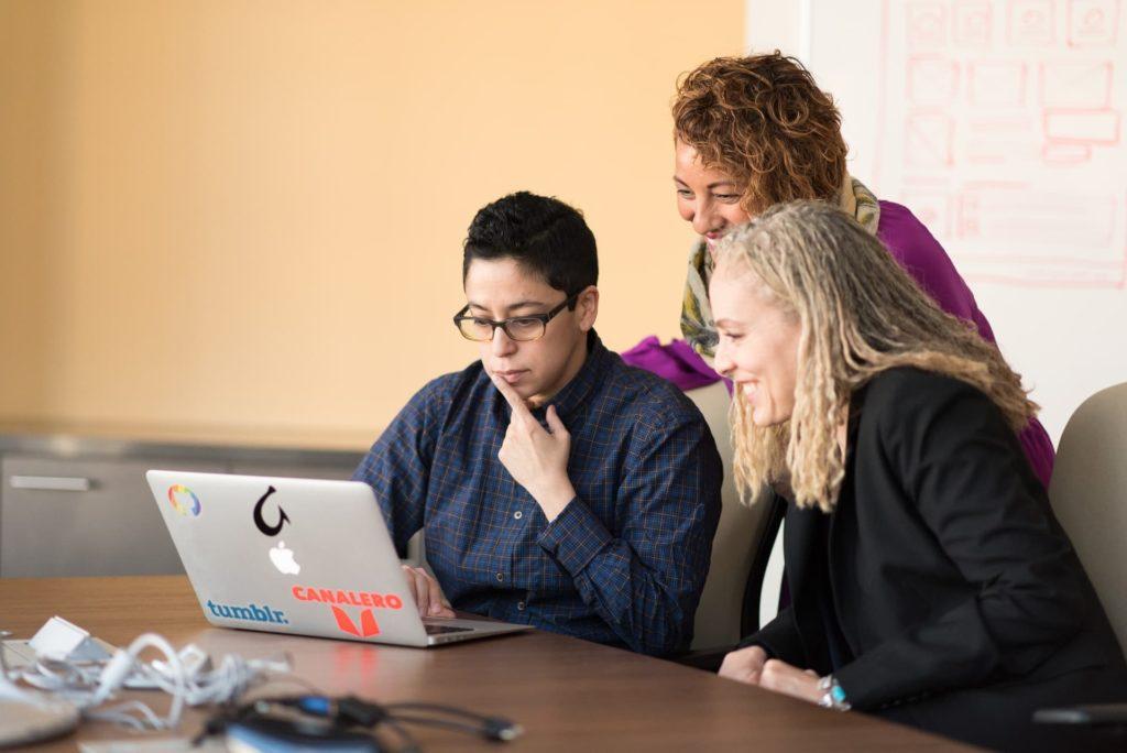 marketing agency job laptop with tumblr sticker