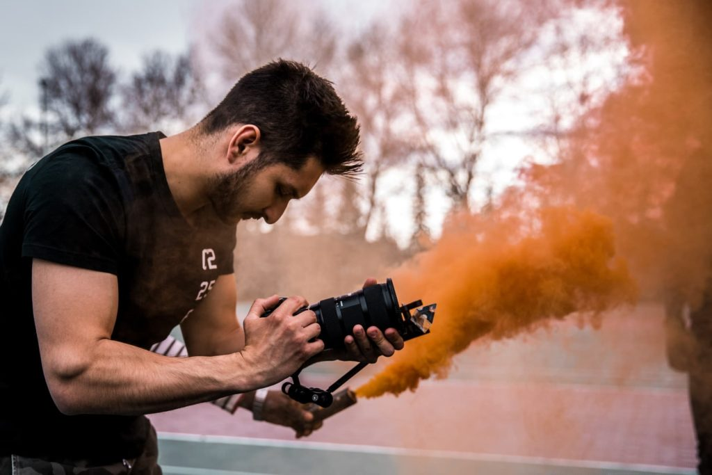 independent filmmaker with camera and smoke on set