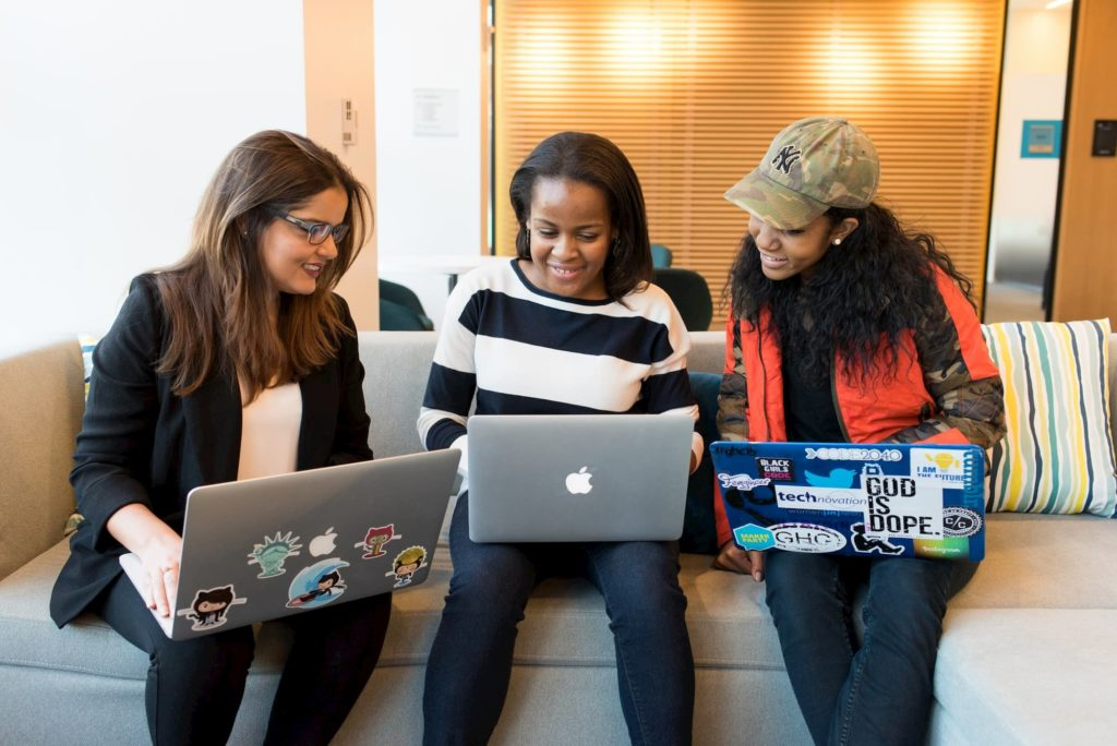 female filmmakers networking on laptops at meeting