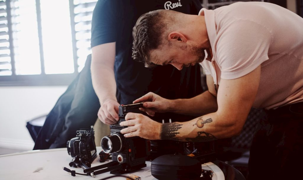 Two-Guys-Adjusting-a-camera