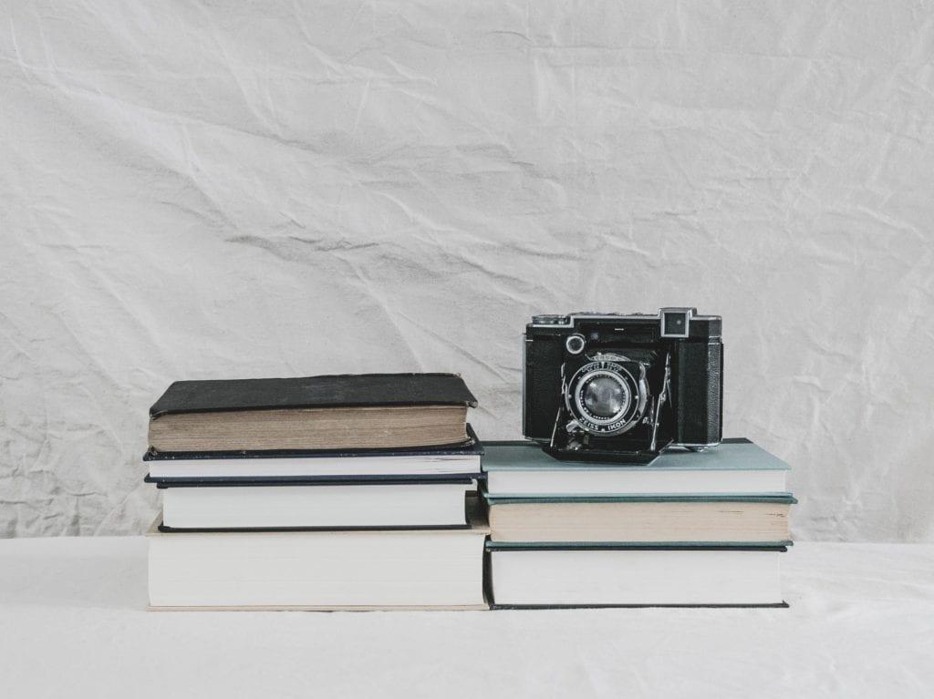 Camera set up on top of worn books film fund.