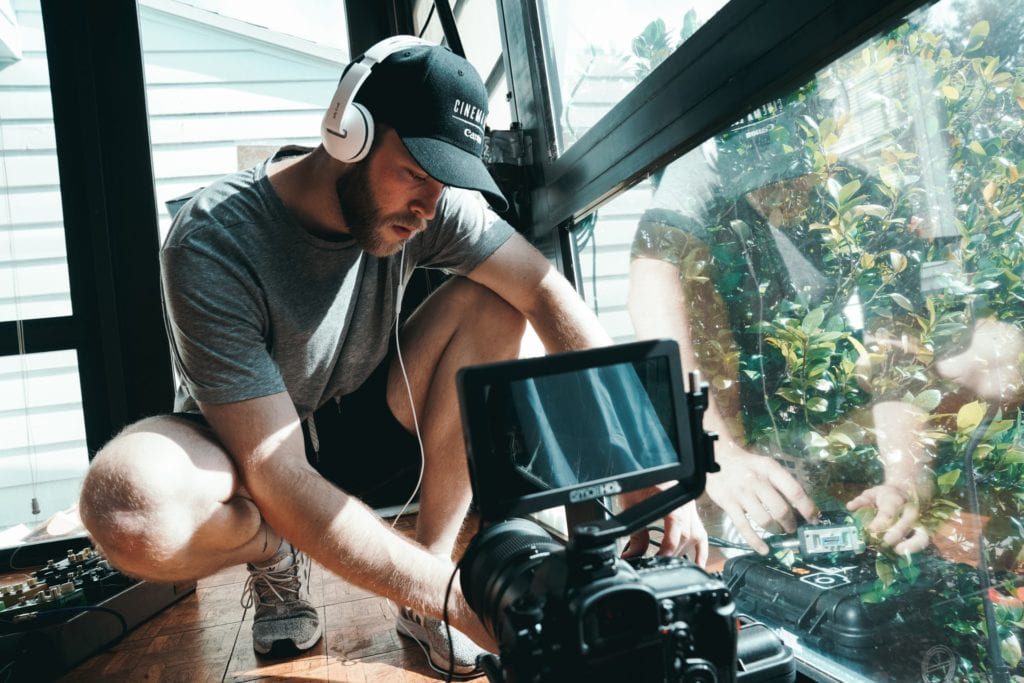 cinematographer setting up camera for filming the film fund