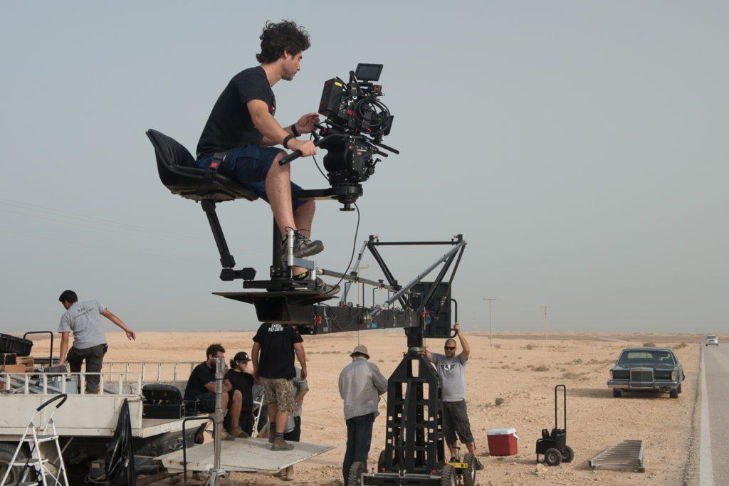 man filming on set the film fund