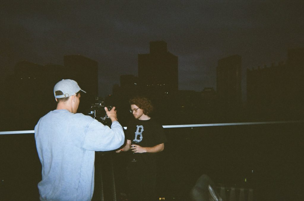 two people filming at night in the city the film fund