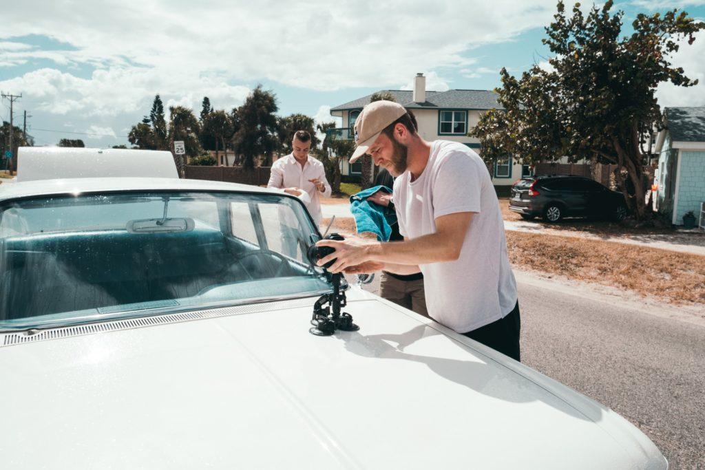 three men helping on a film set the film fund