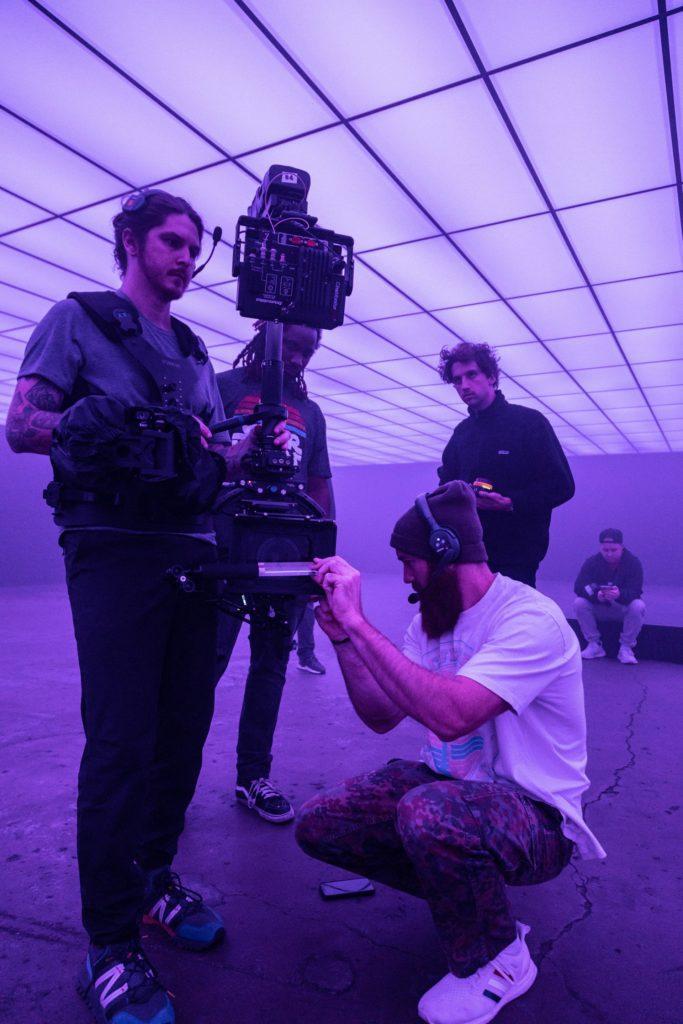 man adjusting camera the film fund