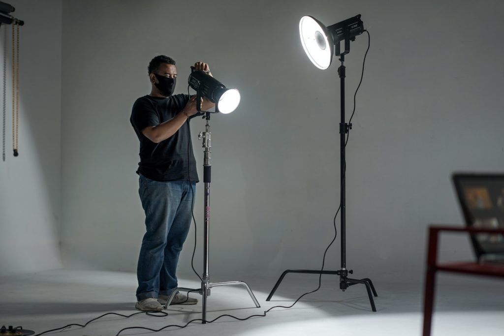 man working with lights on set the film fund