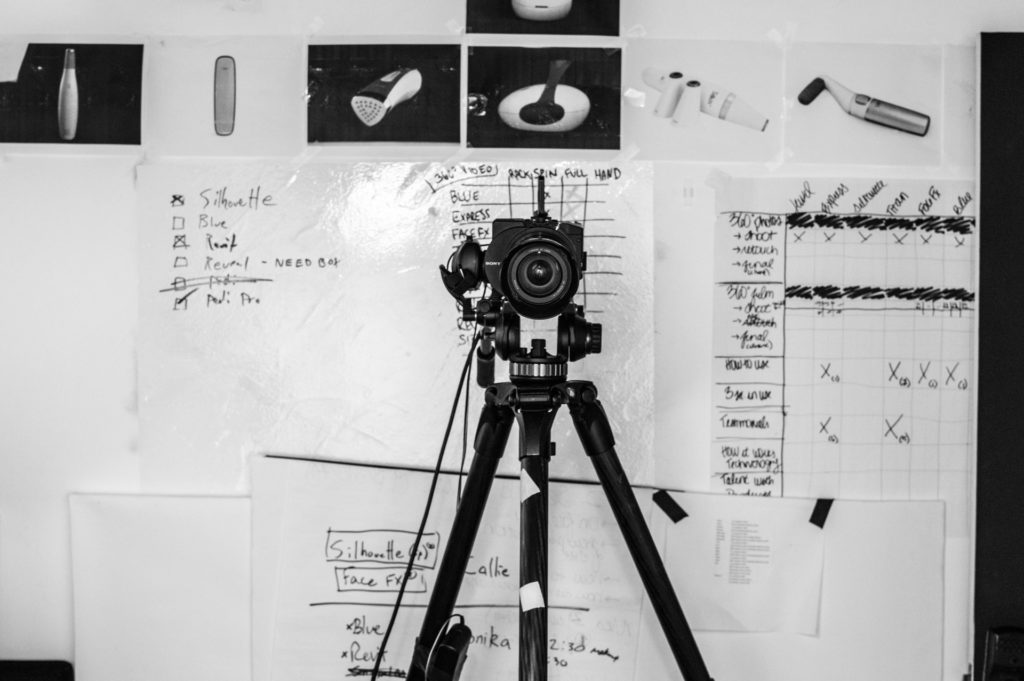 camera in front of a white board the film fund